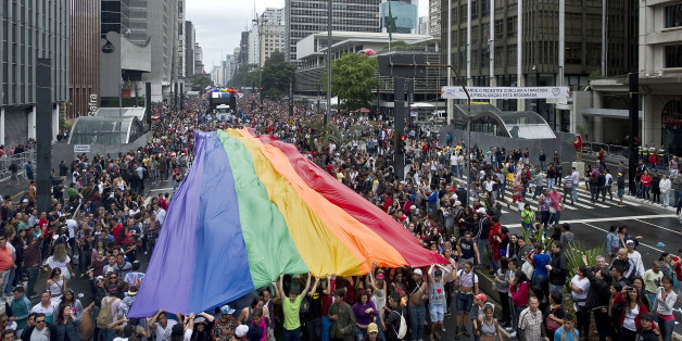 A huge rainbow flag is carried during the annual Gay Pride Parade in Sao Paulo, Brazil, on June 02, 2013. According to organizers, near 4 million supporters are attending the event, making it the biggest gay parade in the world.  AFP PHOTO / NELSON ALMEIDA        (Photo credit should read NELSON ALMEIDA/AFP/Getty Images)